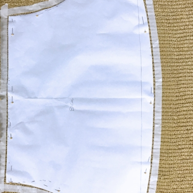 1. Pin pattern to knitted fabric. Tape around pattern with a removable tape.