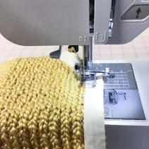 2. Machine stitch inside the tape line 2 times or use a double needle.