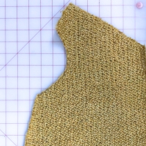 3. Cut outside the machine stiches; tape goes with the excess fabric. Crochet around each piece to hold edges in place. Hand or machine sew pieces together.