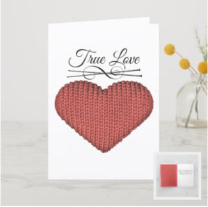 Knit red heart with knitting needles and words true love card