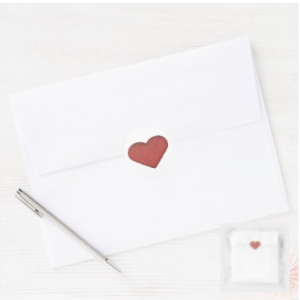 Knit red heart on white background stickers